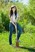 Happy woman gardening with spade — Stock Photo