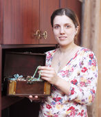 Woman with jewelry in treasure chest — Stock Photo