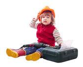 Ребенок выбирает инструменты в панели инструментов — Стоковое фото