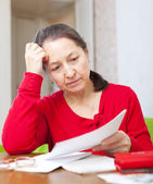 Woman reads payments at home — Stock Photo