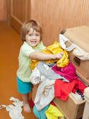 Baby girl chooses dress — Stock Photo