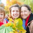 Three generations women in autumn — Stock Photo #23480045