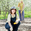Women works at garden in spring — Stock Photo