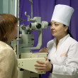 Oculist and patient testing eyesight — Stok Fotoğraf #23480231