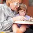 Grandmother and child reads  book — Stock Photo
