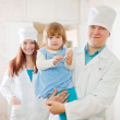 Doctor and nurse with child at clinic — Stock Photo