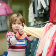2 years baby in clothes shop — Stock Photo