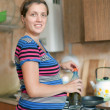 Pregnant woman cooks food — Foto Stock