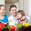 Happy family together  with vegetables in  kitchen — Stock Photo