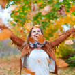 Happy womthrows leaves — Stok Fotoğraf #24183161