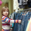 Royalty-Free Stock Photo: child chooses jeans at  shop