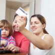 Family of three generations buying online with laptop — Stock Photo #24183211