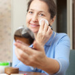 Stock Photo: Womcleans make-up