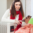 Womreads e-reader near warm radiator — Stock Photo #24183377