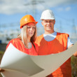 Two workers  at electric power plant — Stock Photo