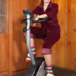 Woman exercise on spinning bike — Stok fotoğraf