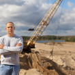 Worker  at sand pit - Stock Photo