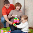 family of three in home — Stock Photo