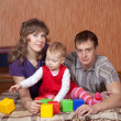 Parents with baby in home — Stock Photo