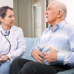 Mature man tells the doctor the symptoms — Stock Photo