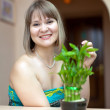 Girl with lucky bamboo plant — Stock Photo #24183593