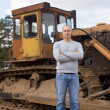Tractor operator at workplace - Stock Photo