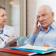 doctor examining the senior patient — Stock Photo