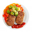 Cutlets with vegetables over white background — Stock Photo #24183807