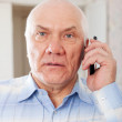 Stock Photo: Senior mspeaking by mobile