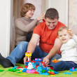 Child plays with meccano set in home — Stock Photo