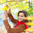 Happy woman at autumn park - Stock Photo
