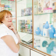 Woman near counter in pharmacy - Stock Photo