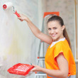 Painter paints wall with roller — Stock Photo #24184179