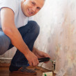 Royalty-Free Stock Photo: man repairs the socket