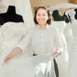Woman shows bridal gown at shop  — Stock Photo