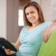 Woman reads e-reader — Stock Photo #24184261