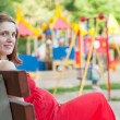 Pregnancy woman against  playground — Stock Photo