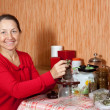 Royalty-Free Stock Photo: Mature woman brews herbs