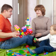 Royalty-Free Stock Photo: parents and child plays with meccano
