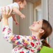 Happy mother holds to her baby — Stock Photo #24184565