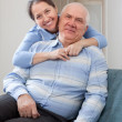 Cheerful mature woman with smiling husband — Stock Photo