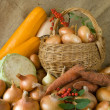 Onion in basket and vegetables — Stock Photo