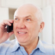 Senior man speaking by mobile — Stock Photo