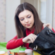 Woman can not finding anything in her purse - Stock Photo