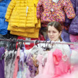 Mother chooses clothes for child — Stock Photo #24184793