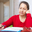 Serious woman reads documents — Stock Photo