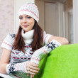 Girl in knitted hat relaxing at home - Stock Photo