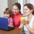 Happy women  of three generations using laptop   — Stock Photo