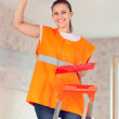 Stock Photo: Female house painter paints the ceiling
