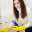 Stock Photo: Womcleans bathroom